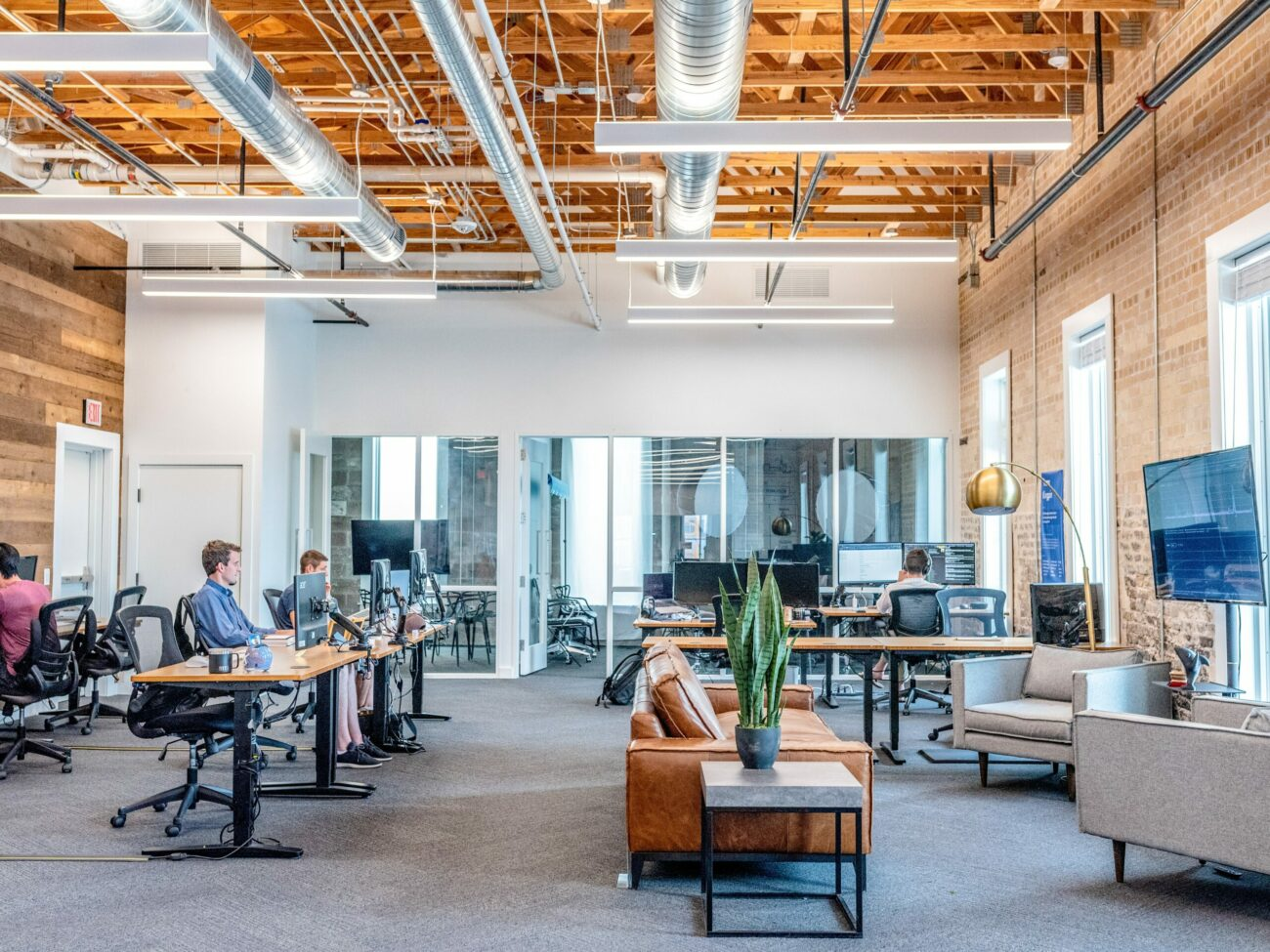 open office spaced filled with people working at their latops