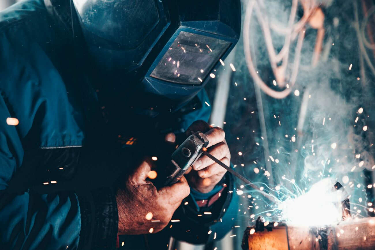man welding with sparks flying out