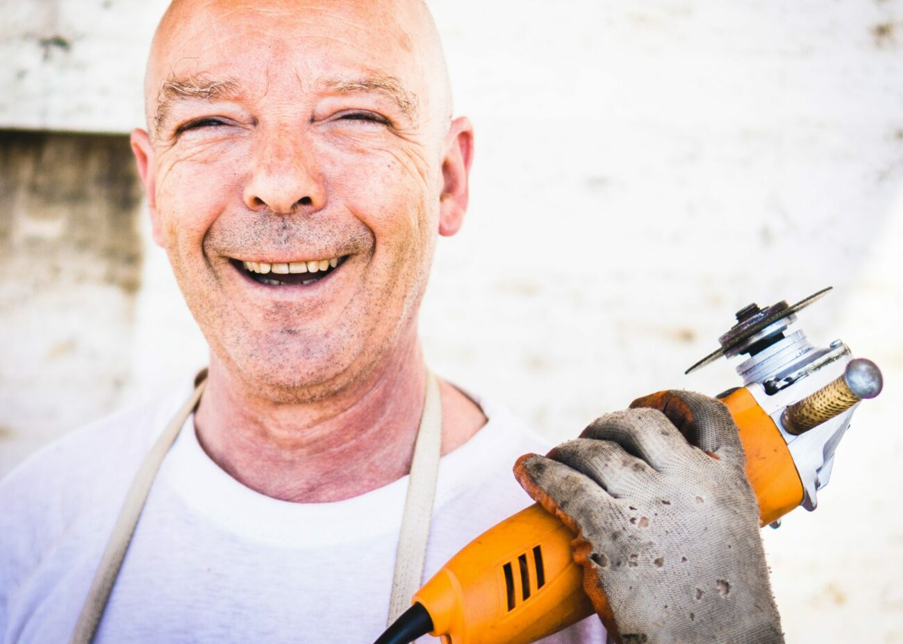 man holding a saw smiling