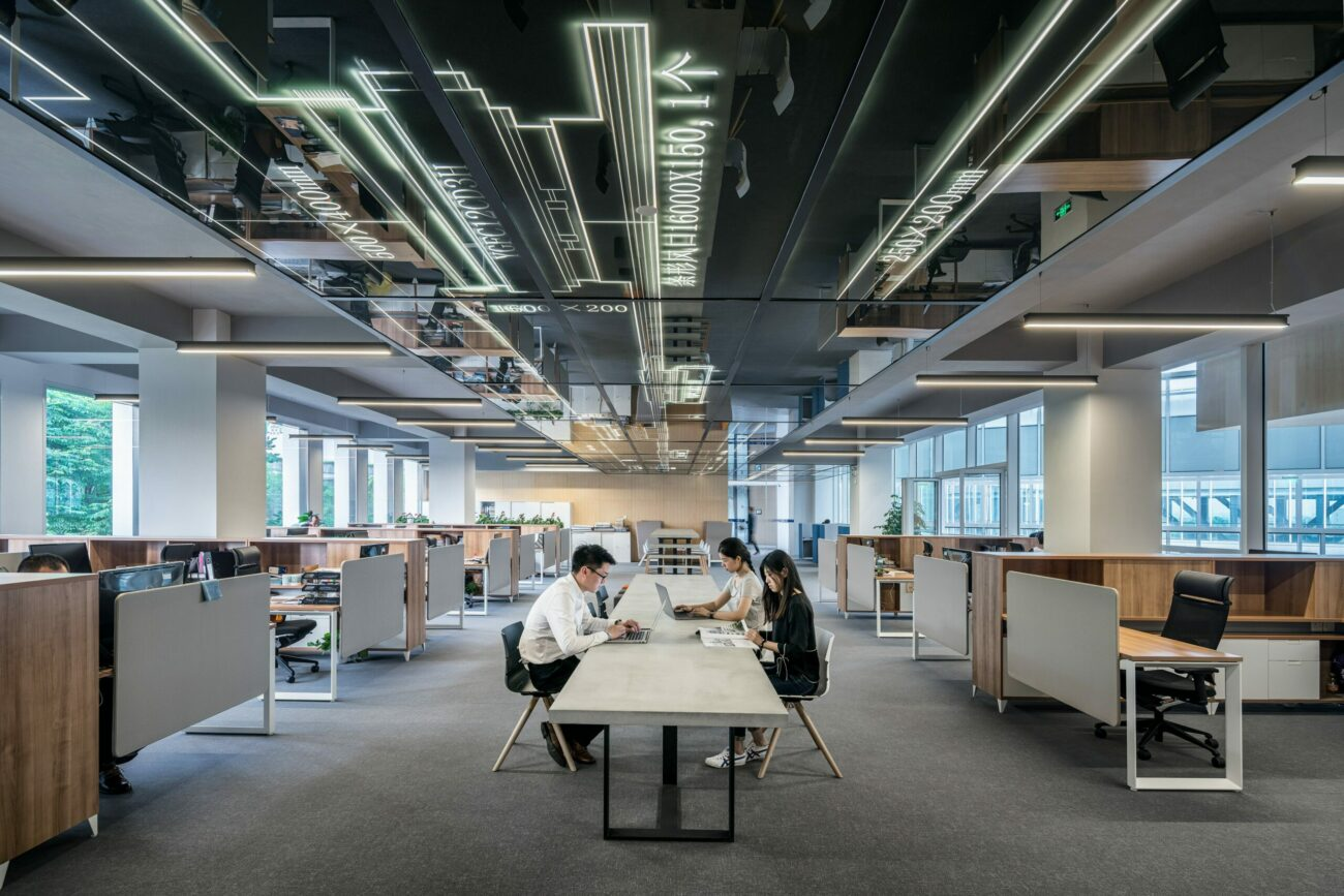 open office space with a long working table in the middle